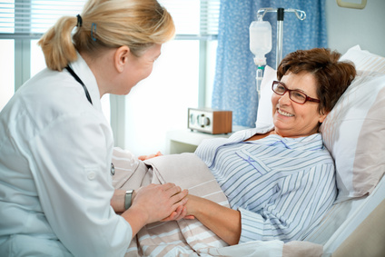 doctor or nurse talking to patient in hospital